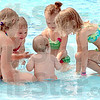 Pool party: A group of young children play in the kiddie pool in Rockville Friday morning.