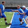 Basics: Coach Mike Simmonds, right works with Indiana State University linemen Adam Masters and Evan Norris Friday.