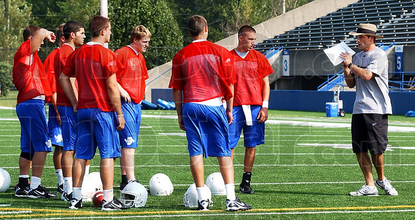 Teaching: New Indiana State backfield coach Steve Englehart works with his quarterbacks at practice Friday.
