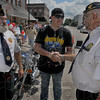 Thanks: Clinton American Legion post Commander Randy Helms, left, and post Chaplain Roy Dickson, right, greet Army Sgt. Michael Harris as he arrives in Clinton Saturday afternoon.