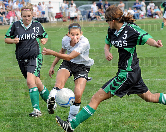 Shot on goal: South's #11, Kathryn Sensemen takes a shot against West Vigo's #5, Allison Fifer and is trailed on the play by #13, Kaitlyn Benefiel during Saturday's Soccer Jamboree at Terre Haute North.