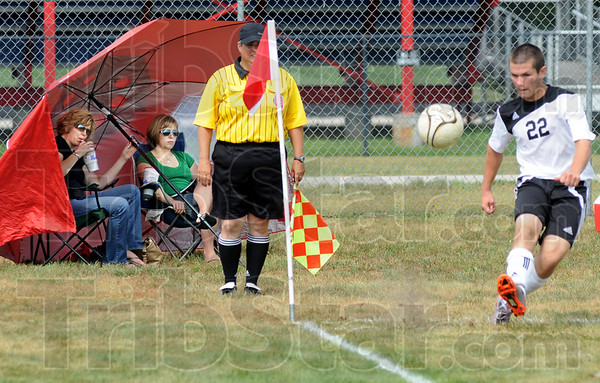 Made in the shade: South's #22, Nic Henderson gets a corner kick during Saturday's Soccer Jamboree at Terre Haute North. Watching the action from the shade of an umbrella tent is Annmarie Switzer and her daughter Hannah.