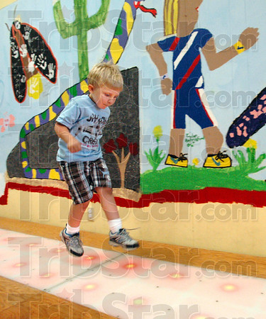 Fun to run: Four-year-old Aaron Robinson of Terre Haute spends some time attempting to run as fast as wild animals  in the Terre Haute Children's Museum Saturday afternoon. The museum is closing Saturday and moving to its new location at 8th and Wabash where they will prepare for the grand opening.