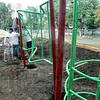 New: A group of Unison volunteers work to construck new playground equipment Saturday morning at Deming School.