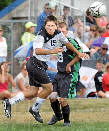 Intense: South's # 15, Paul Pendergast watches the flight of the ball after clearing it away from West Vigo's Dan Debard.
