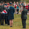 Tribune-Star/Joseph C. Garza<br /> Each fold has meaning: Terre Haute South Army Jr. ROTC Cadet Sgt. 1st Class Bryan Kelty makes the 11th fold of the flag during the flag ceremony before the Run for the Fallen Saturday at Memorial Stadium.