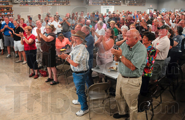 """Tribune-Star/Joseph C. Garza<br /> A standing """"O"""" for Joe: Attendees stand to offer Maricopa County Sheriff Joe Arpaio a standing ovation at the end of his speech Saturday in the Sullivan County 4-H building."""