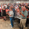 "Tribune-Star/Joseph C. Garza<br /> A standing ""O"" for Joe: Attendees stand to offer Maricopa County Sheriff Joe Arpaio a standing ovation at the end of his speech Saturday in the Sullivan County 4-H building."