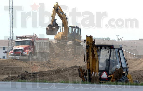 Digging dirt: Work continues on improvements to Thompson Ditch between South 7th Street and US 41.