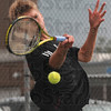 Tribune-Star/Joseph C. Garza<br /> Top spin return: Terre Haute South's Cam Crawford hammers a forehand back to his Center Grove opponent during their No. 1 singles match Saturday at South.