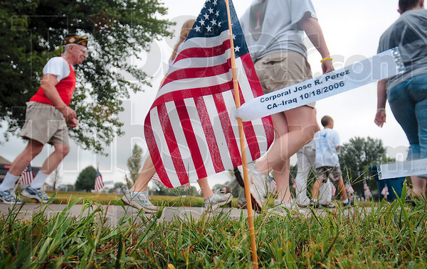 Tribune-Star/Joseph C. Garza<br /> Every flag a life lost: Participants in Saturday's Run for the Fallen pass a flag that memorializes the late Cpl. Jose Perez at Memorial Stadium.