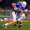 Wrapped up : Blue team reciever Justin Hilton is wrapped up by Terre Haute South product Bryn Schwartz after a short gain.