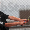 Tribune-Star/Joseph C. Garza<br /> Power from either side: Terre Haute South's Cam Crawford returns a backhand to his Center Grove opponent Saturday at South.