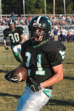Tribune-Star/Joseph C. Garza<br /> Makes you want to shout: West Vigo's Cole Lydick celebrates his touchdown run in the first quarter of the Vikings' game against Greencastle Friday at West Vigo.