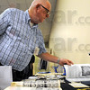 Remember when: Concannon Class of 1960 member Paul Akers scans an old yearbook during Saturday's 50th reunion at The Landing.