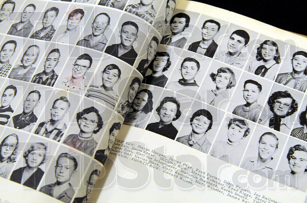 Concannon kids: A yearbook displays the faces of the Class of 1960 as 8th graders Saturday evening during the 50th anniversary of graduation.