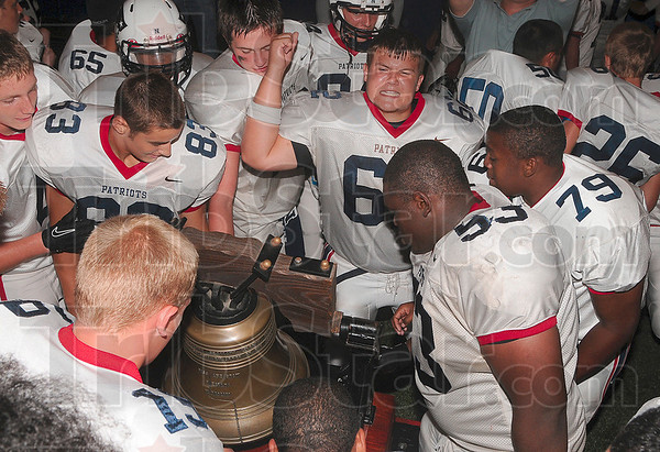 Tribune-Star/Joseph C. Garza<br /> The ring of victory: Terre Haute North's Justin Coyle celebrates after he rang the Victory Bell moments after the Patriots defeated the South Braves in overtime at Memorial Stadium Friday.