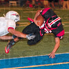 Tribune-Star/Joseph C. Garza<br /> Terre Haute South's Tre Stephens dives into the endzone to score against the North defense during the annual North-South football game Friday at Memorial Stadium.