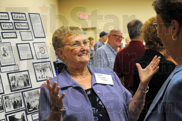 Is that you?: Sandy Morgan reacts to seeing Linda Scott (R) as the two reunite for the Class of 1960 Concannon High School 50th reunion.