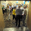 Standing room only: Members of the Concannon High School  Class of 1960 gather in a room of The Landing Saturday night for their 50th reunion.
