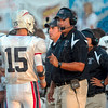Tribune-Star/Joseph C. Garza<br /> Terre Haute North quarterback Chad Holler talks with coach Chris Barrett before the next play during the Patriots' win Friday over Terre Haute South at Memorial Stadium.