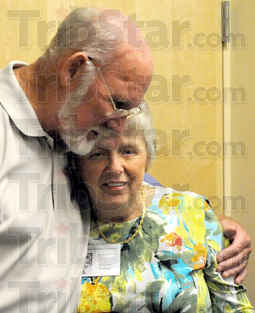 Classmates: Jim Moss hugs Sharon Ramsey as they reunite at the 50th anniversary of the Class of 1960 Saturday evening.