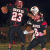 Tribune-Star/Joseph C. Garza<br /> Terre Haute South's Tre Stephens (23) celebrates his touchdown run with teammate Kevin Bracken (6) during the annual North-South football game Friday at Memorial Stadium.