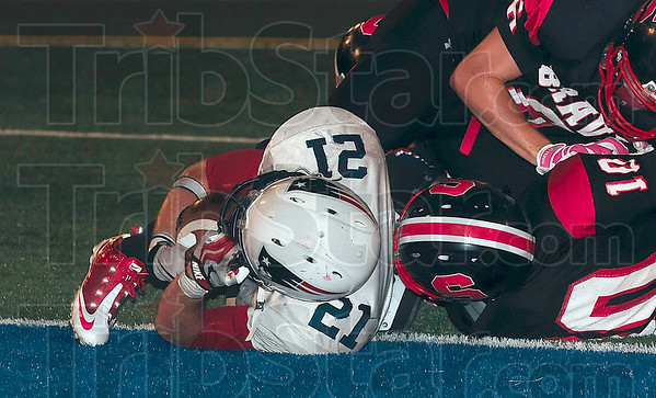 Tribune-Star/Joseph C. Garza<br /> Game winner: Terre Haute North's Daniel Gabbard (21) falls into the endzone in overtime to help the Patriots win the annual North-South game at Memorial Stadium Friday.