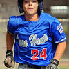First run: Brett Herndon allows himself a grin after scoring the first run of their game with Owensboro Southern Saturday in Indianapolis.