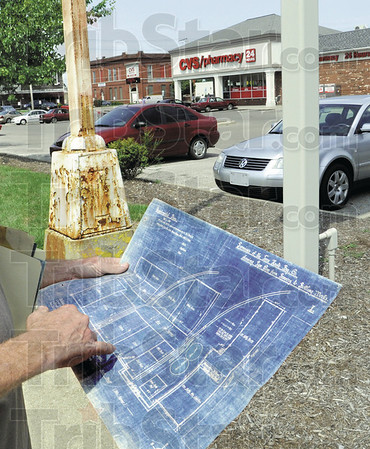 Here: Mike Rowe holds a blueprint showing the underground cellars that were once the Terre Haute Brewry. He believes there may be an underground speakeasy from years ago in the catacombs under the CVS parking lot at 9th and Poplar.