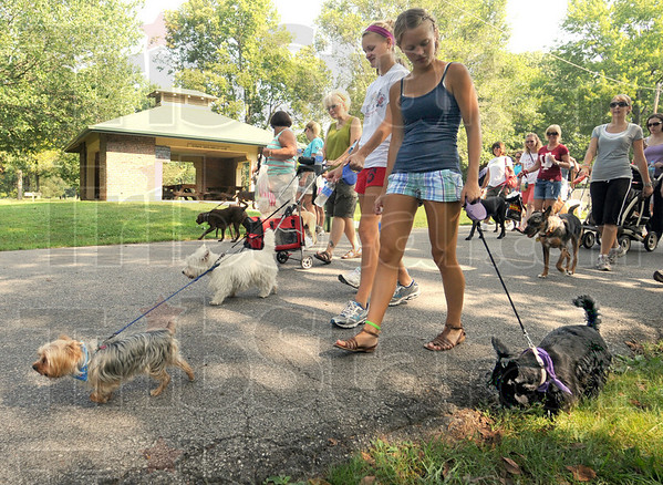 Bark walkers: Emily and Mallory Reed walk their dogs Harvey and Ella during Saturday's annual Bark in the Park.