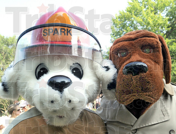 Mascots: Sparky the fire dog and McGruff police dog attended the annual Bark in the Park event Saturday at Deming Park.