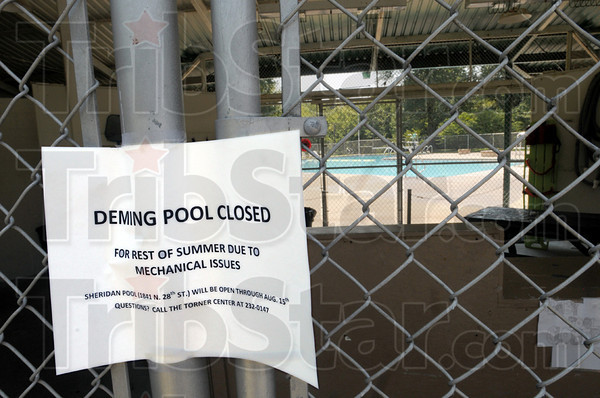 Closed: A sign at the main entrace to the Deming Pool announces its closing.