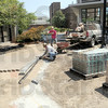 Walkin' the walk: Stephanie Booker and Ed White of White's Creative Landscaping create a walk in a courtyard on the Indiana State University campus Wednesday afternoon. White says the work will be done in time for the start of the new school year.