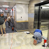 Remodeled: Tim Harlan (L) walks the upper floor of the newly renovated Sandison Hall Wednesday afternoon as Kathy Kintner vaccums and Barbara Cuffle cleans the floor at the entrance to the elevator. Harlan was the dorm director at the facility in 1976 and currently teaches english on the campus.