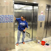 Clean: Barbara Cuffle cleans one of the new elevators in Sandison Hall on the ISU campus Wednesday afternoon in preparation for the new school year.