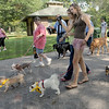 Picture this: Two girls review photographs as they walk their dogs during the Bark in the Park event Saturday.