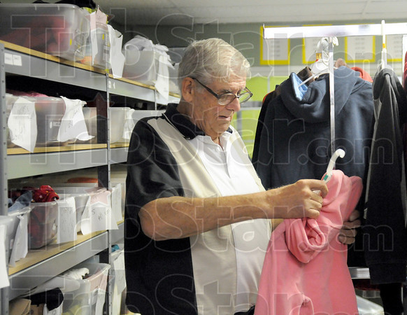 Hang-time: Richard Maher volunteers his time to the Kid Kare Project Wednesday afternoon. He's putting clothes on hangers for distribution to needy individuals.