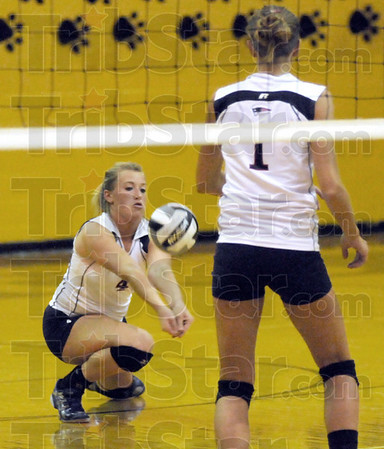 Return: North's #4, Mary Kate Etling receives serve during Wednesday's game at South Vermillion.