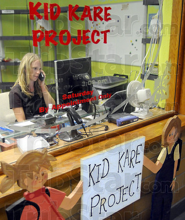 Volunteer: Heather Delaney answers the phone while volunteering her time to the Kid Kare Project in Clinton.