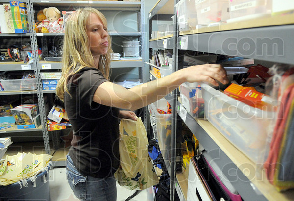 Packaging: Heather Delaney makes fills a bag with items at the Kid Kare Project Wednesday afternoon. She's volunteering some time prior to her night work shift at Eli Lilly.