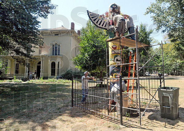 Restoration: A crew works to repair and restore the totem pole in front of the Vigo County Historical Museum Wednesday afternoon.