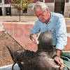 Tribune-Star/Joseph C. Garza<br /> A little off the top: Sculptor Bill Wolfe cleans up his statue of poet Max Ehrmann near the corner of Seventh Street and Wabash Avenue Wednesday in preparation for today's unveiling ceremony.