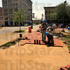 Making progress: A group of bricklayer apprentices has been working on the brick walkway at the site of the Max Ehrman schupture at 7th and Wabash. About 7,000 bricks will be used in the project