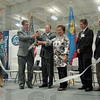 Ribbon cutting: Mayor Duke Bennett, Peter Allart and Claudia Fritsche cut the ribbon for the opening of the new Thyssenkrupp Prest expansion Wednesday morning.