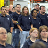 Stand behind product: Workers of  Thysenkrupp Presta listen to their president Peter Allart during the ribbon cutting ceremony Wednesday morning in the Industrial Park facility.