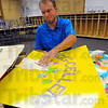 On the job: Terre Town Elementary School teacher Justin Moore works on signs for his classroom Monday afternoon.