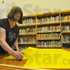 Getting ready: Terre Town Media Specialist Marti Petscher prepares a bulletin board for the coming school year.