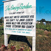 """Tribune-Star/Joseph C. Garza<br /> A group effort: The sign in front of the """"The Giving Garden"""" at the Wabash Valley Fairgrounds lets passers-by know that its a group effort at the garden which donates produce to local charities."""