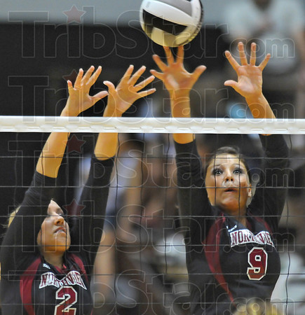 Holding the line: Knights Lizzie Emmert(2) and Brylie Riddell(9) defend against a pioneer spike Monday night in the Northview gym.